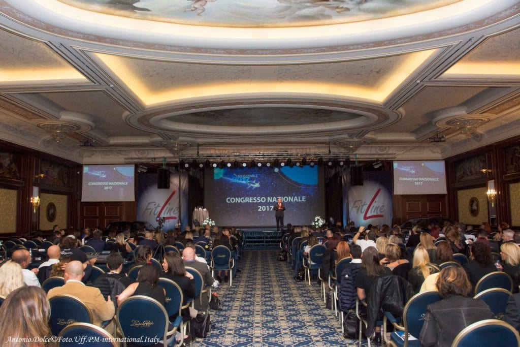 come lavore online con pm international sala congresso